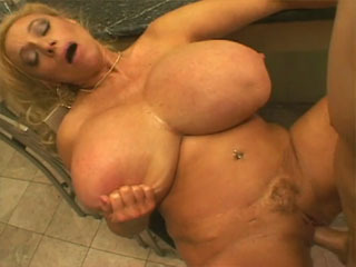 A horny cougar with giant boobs needs some dick