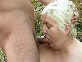Older Blonde Guzzles Dick