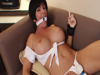 Busty Stepmom Gagged And Pleasured By A Toy