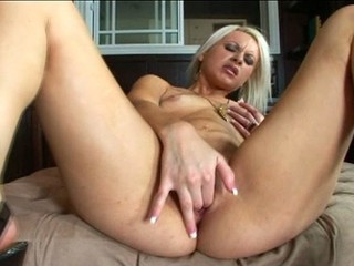 A Blonde Teen Pleasures Herself