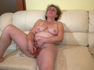 Nice Blonde Hairy Granny Is Fucking A Dildo