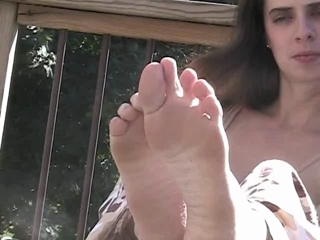 Jersey Massages Her Sexy Feet On The Terrace