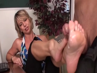Sexy Blonde Gives A Flirty Footjob