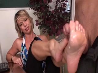 Sexy Blonde Gives A Flirty Footjob