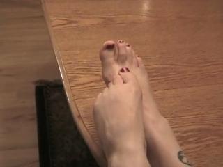 Jillian Enjoys Putting Her Bare Feet On The Table