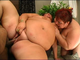 Two mature BBWs share a cock