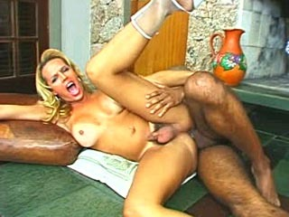 Blonde Latin Shemale Rides A Big Cock
