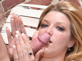 Hot blonde Crystal strokes a cock by the pool