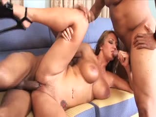 Busty babe gets a double-dick sandwich