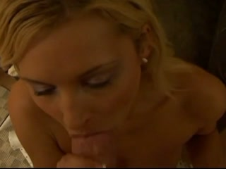 Naughty blonde sucking a cock
