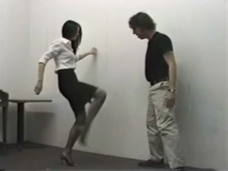 Lady In High Heels Kicking Guy In Balls