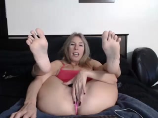 Naughty Mature Blonde Lifts Her Sexy Feet Up In The Air And Rubs Her Snatch On The Camera