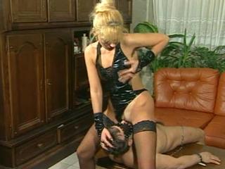 Blonde Dominatrix uses her slave boy