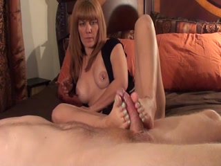 Mature Woman Gives A Slippery Footjob