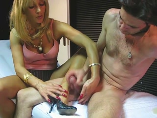 MILF Jerks Off Her Young Lover